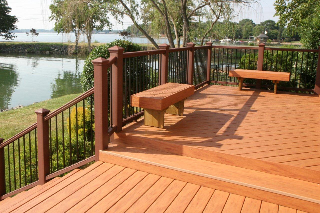Metal fire pit on wood deck - Archadeck Of Charlotte Designed And Built This Composite Deck Rail And Benches At Lake