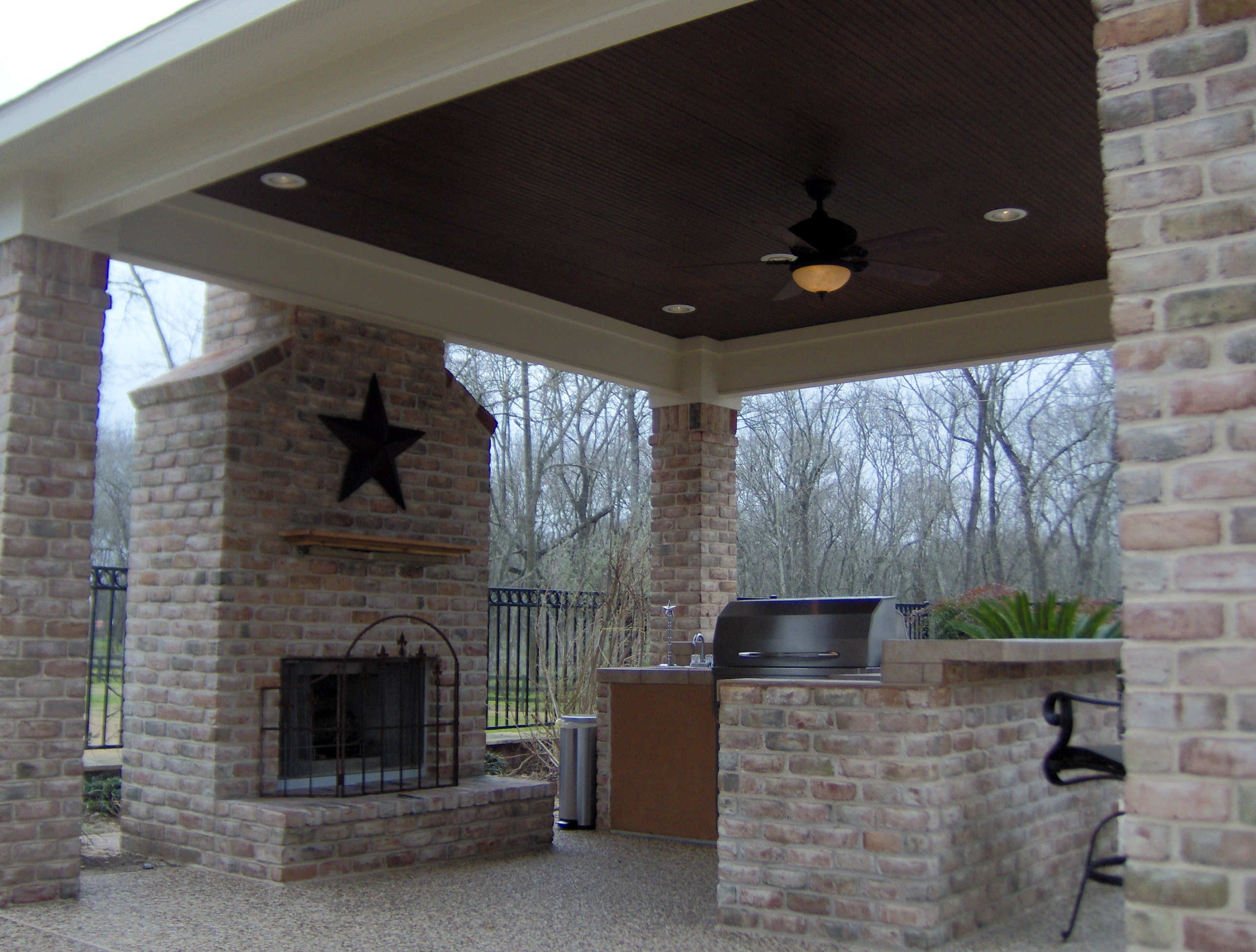Open porch archadeck of charlotte Outdoor fireplace design ideas