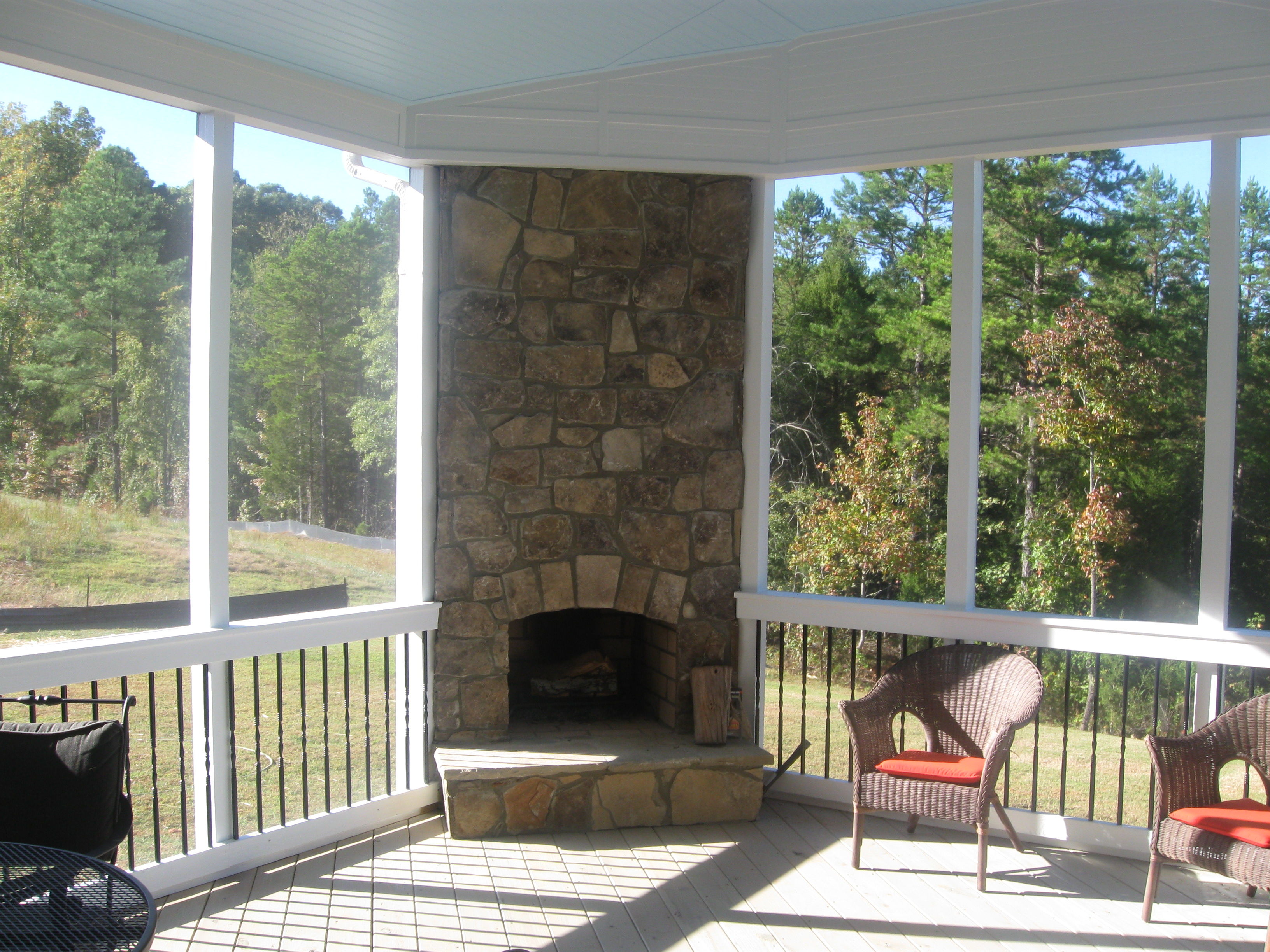 Putting your outdoor fireplace integrated into your screen for Outdoor porches and patios