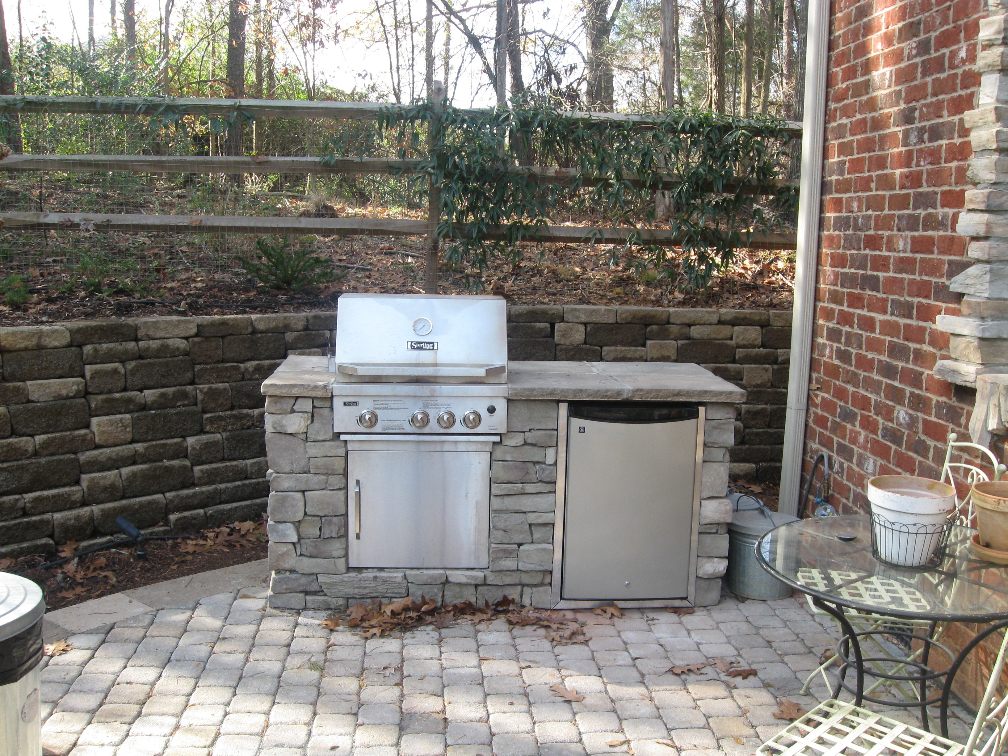 Do i need a special grill or drop in grill for my for Outdoor stone kitchen designs