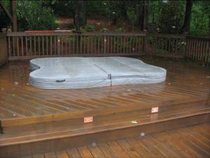 wood deck with hot tub and low voltage deck lights