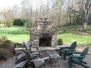 stone patio with stone outdoor fireplace