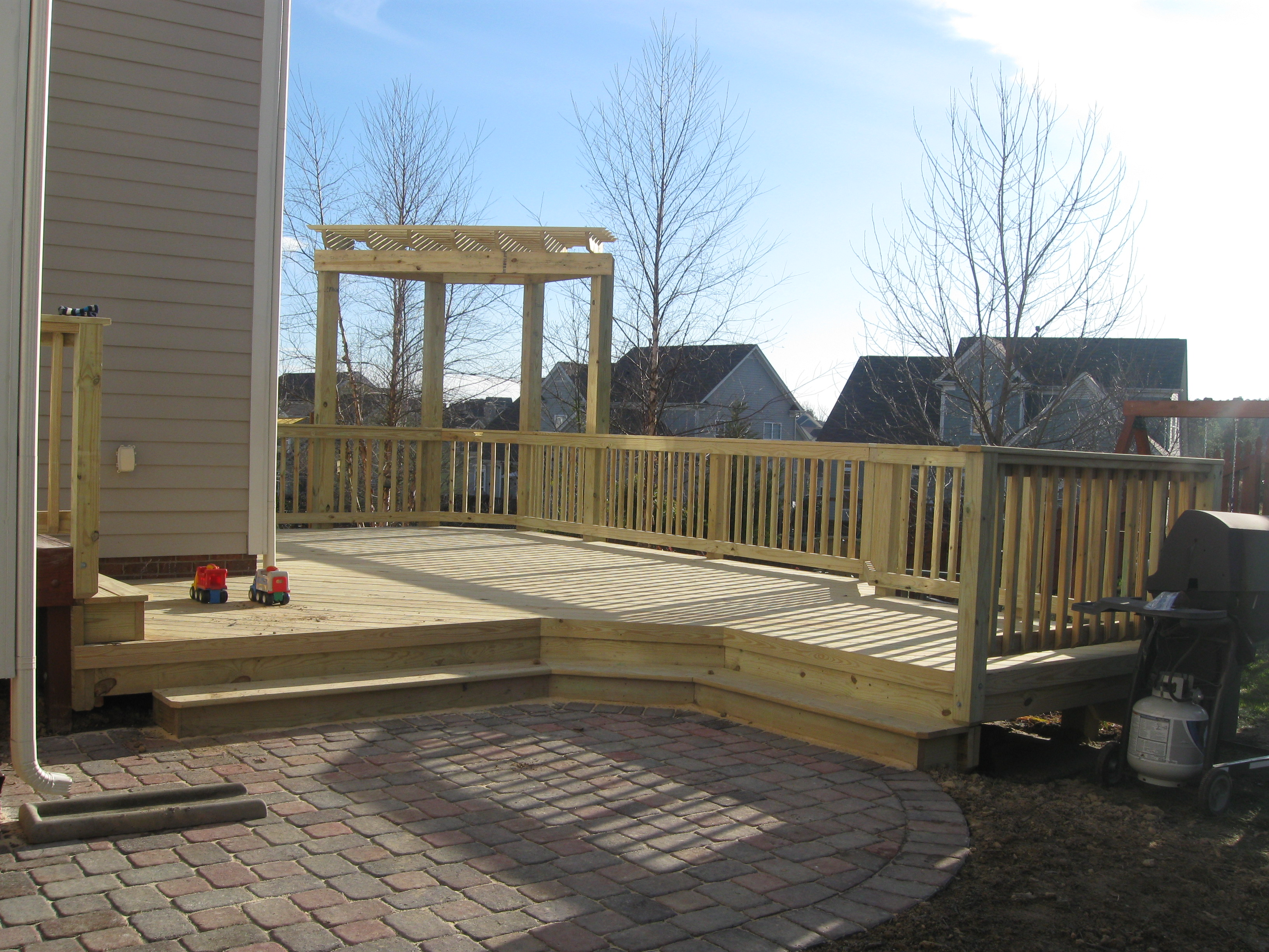 Stone Patio With Wood Deck And Pergola