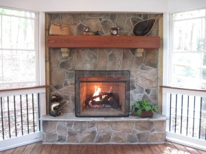 Screen Porch with EZ Breeze windows and stone outdoor fireplace