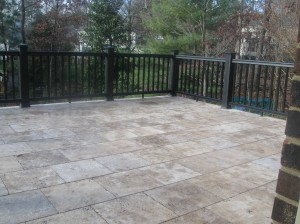 Charlotte home with raised stone patio and TimberTech black Radiance rail