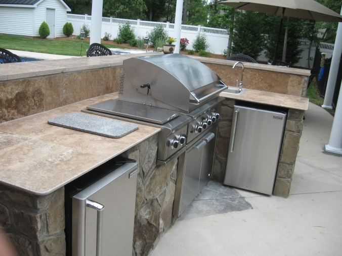 stone outdoor kitchen Charlotte with travertine countertop