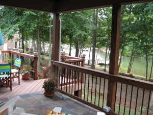 Charlotte outdoor living covered patio with black railing