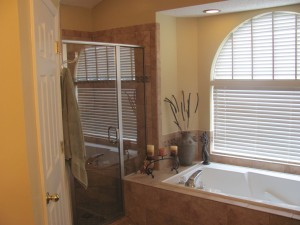 Complete shower, bath tub, flooring, and cabinet remodel by Value Remodelers