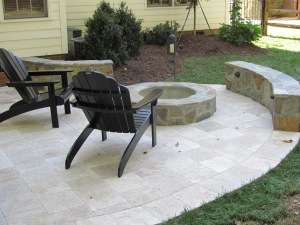 Charlotte Travertine patio with flagstone custom fire pit and flagstone seating wall