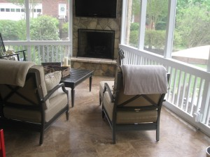 Archadeck of Charlotte built screen porch with outdoor fireplace and travertine