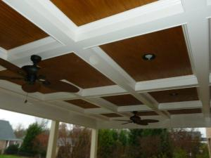 Screen porch by Archadeck of Charlotte with cofered ceiling and can lights