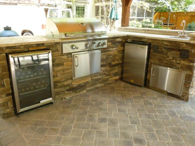 Paver patio with stone outdoor kitchen in Charlotte