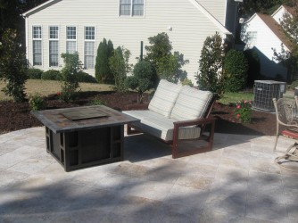 Travertine stone patio and landscape design in Charlotte