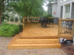 Pressure-treated wood deck with wood rail and Deckorator Baroque pickets in Charlotte, NC
