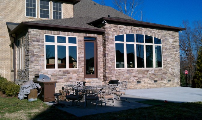 This brick sunroom was designed and built by Archdeck of Charlotte