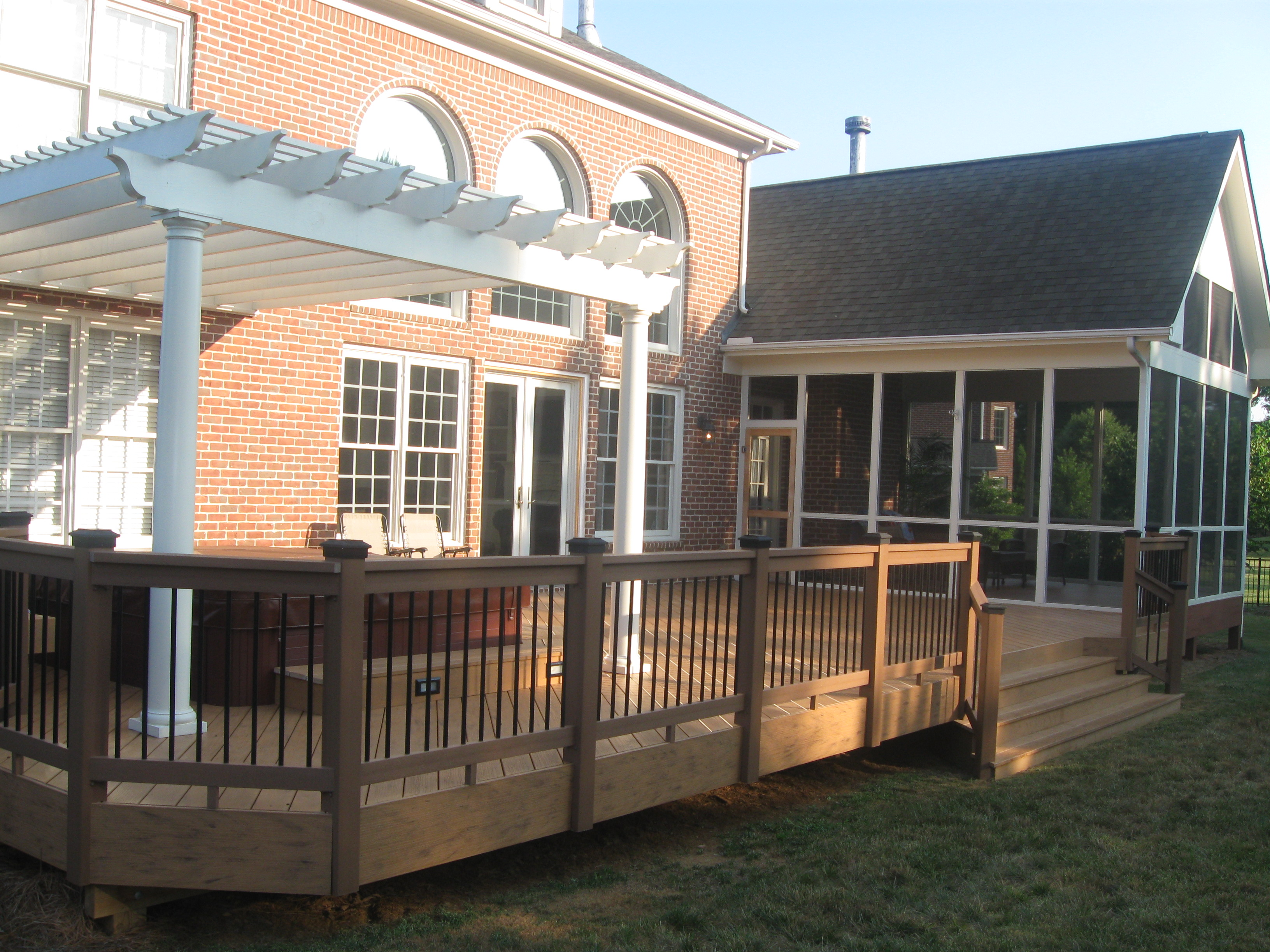 Covered patio archadeck of charlotte for Deck house designs