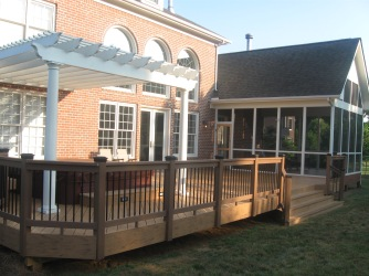 Trex deck with pergola and composite rail by Archadeck of Charlotte