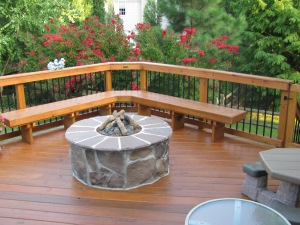 Archadeck of Charlotte designed and built wood deck and stone fire pit
