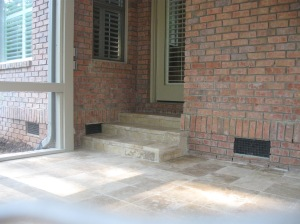 Travertine stone patio in Charlotte with stone steps