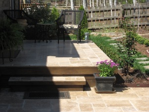 Travertine stone raised patio in Charlotte by Archadeck with stone steps