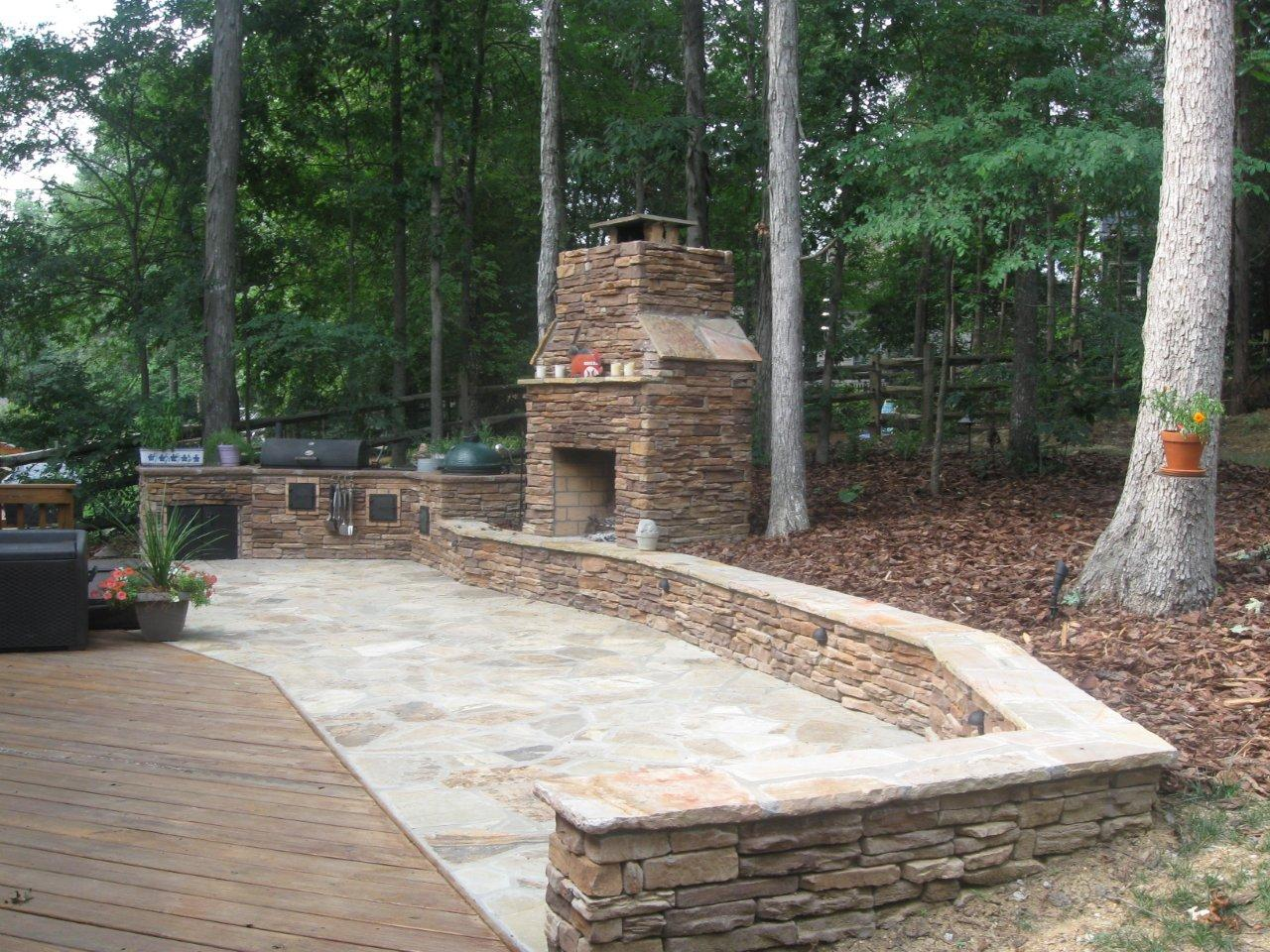 Outdoor Fireplace With Ledgestone On Flagstone Patio Archadeck Of