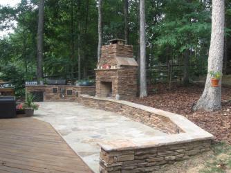 Outdoor Fireplace with ledgestone on flagstone patio