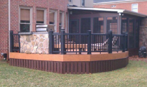 Archadeck of Charlotte designing and built this beautiful Trex deck and rail with a stone outdoor kitchen and screen porch