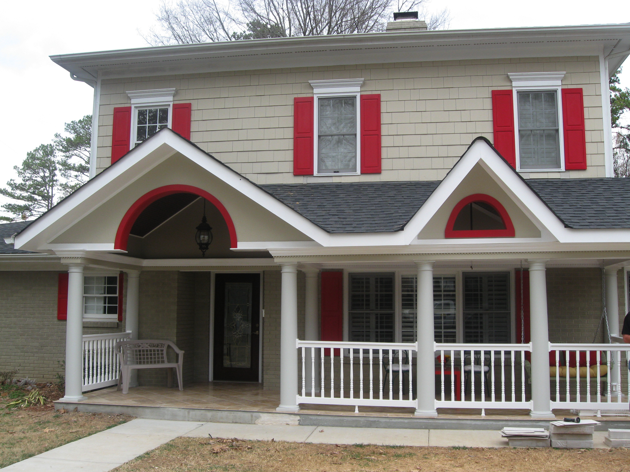 Custom porch by archadeck of charlotte in myers park area with round fiberglass columns and vinyl