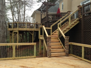 Pressure-treated wood deck that is multi-tiered and designed and built by Archadeck of Charlotte