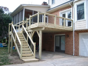 ARchadeck of Charlotte, designed and build this wood deck with stain by Renew Crew