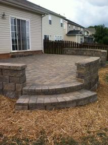 Archadeck of Charlotte designed and built this pave patio with paver steps and sitting walls