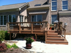 Archadeck of Charlotte designed and built this Trex Transcends composite deck and rail with architectural steps