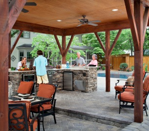 Archadeck of Charlotte designed and built this covered outdoor kitchen with a cabana and all of the outdoor appliances including a Fire Magic AOG Grill