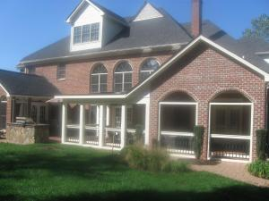 Archadeck of Charlotte designed and built this brick screen porch with EZE Breeze windows