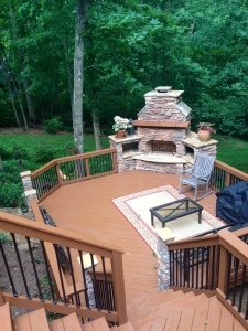 Multi-level deck with stone outdoor fireplace by Archadeck of Charlotte