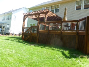 Pressure-treated wood deck with English Lattice and pergola in Huntersville, NC by Archadeck