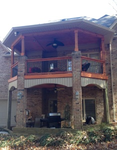 Double-decker porch with brick and cedar colums and a dry deck system in Matthews, NC