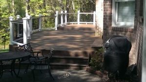 Trex Transcends deck and rail by Archadeck of Charlotte with metal Decorator pickets