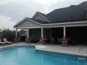 Archadeck designed this covered pool patio with a difficult roof line in Charlotte