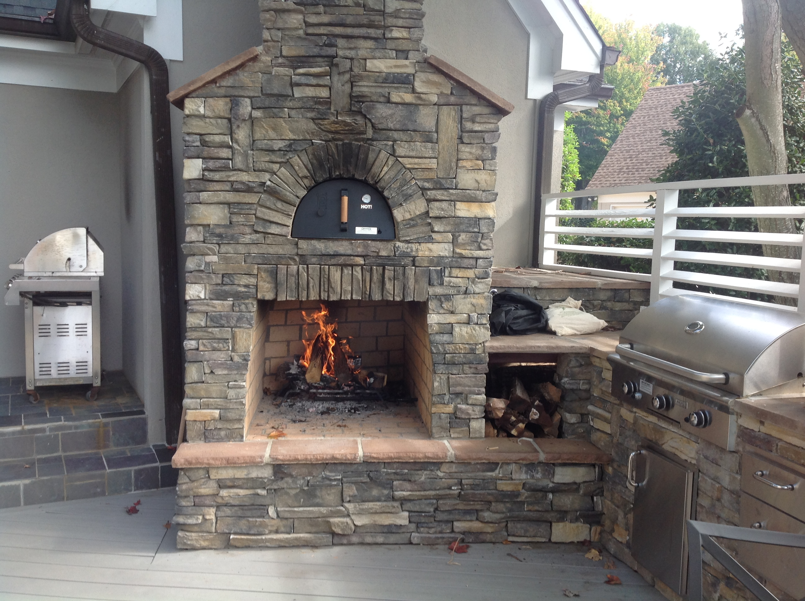 Custom Outdoor Fireplace And Pizza Oven With An Outdoor Kitchen On A Trex  Transcends Gravel Path Part 85