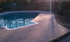 Archadeck of Charlotte designed and built the herringbone pattern pool deck with brick pavers