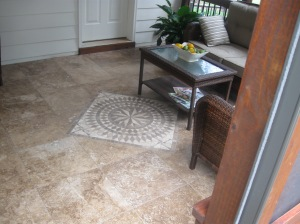 Archadeck of Charlotte designed and build this screen porch with Travertine porch floor