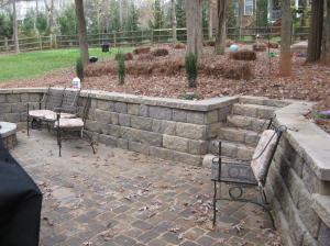 Archadeck of Charlotte designed and built this decorative retaining wall and paver patio with paver steps