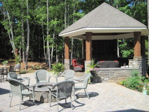 Archadeck of Charlotte designed this Gazebo pool cabana with fire pit and patio