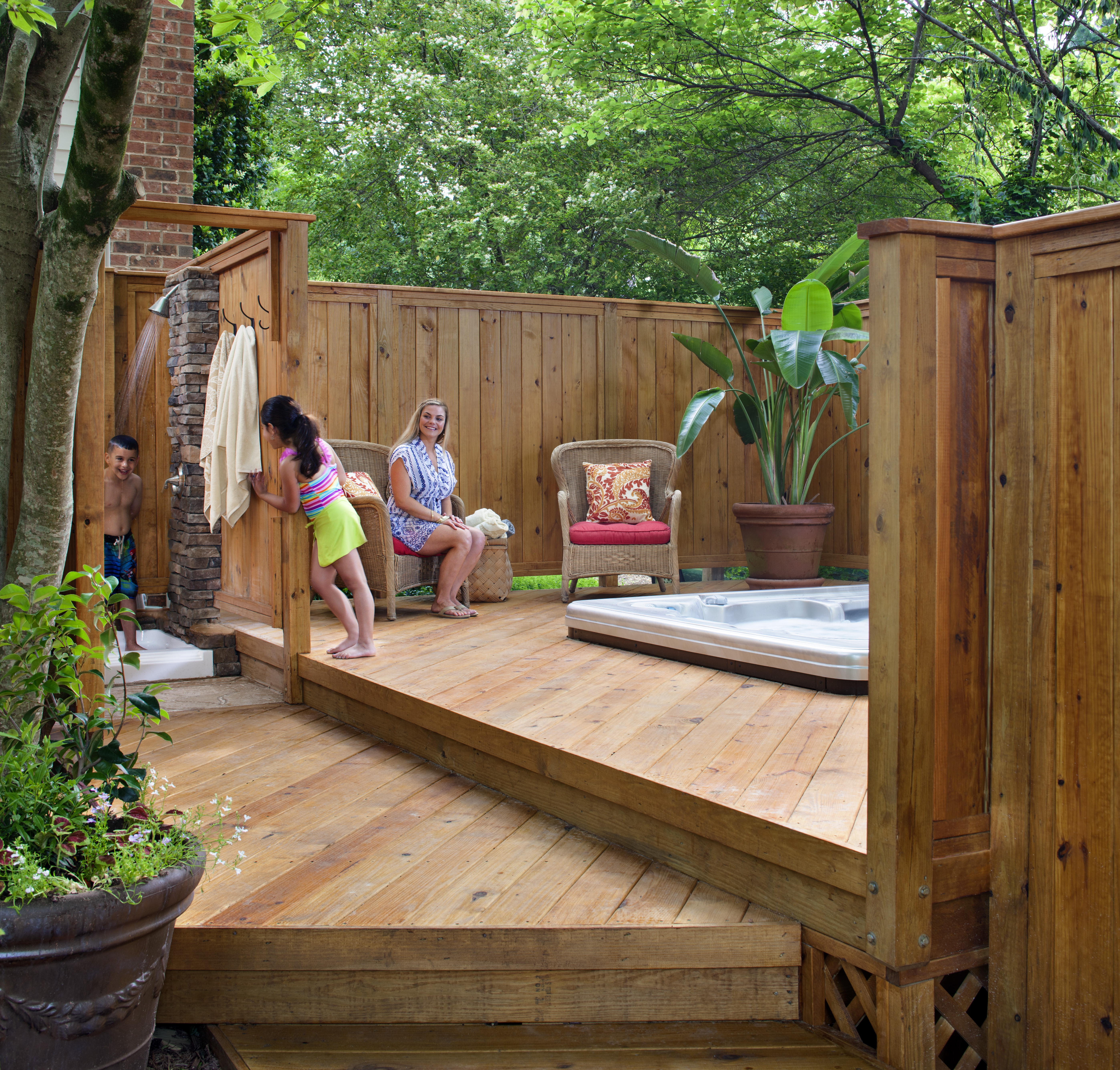 hot tub deck with a privacy fence and outdoor shower by archadeck of charlotte