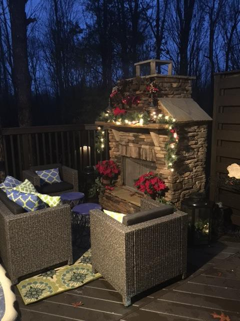 2nd story outdoor fireplace on a deck by Archadeck of Charlotte