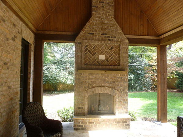 Brick Gas Outdoor Fireplace under covered patio