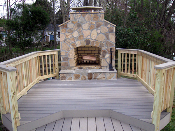 Charlotte deck building composite deck outdoor fireplace